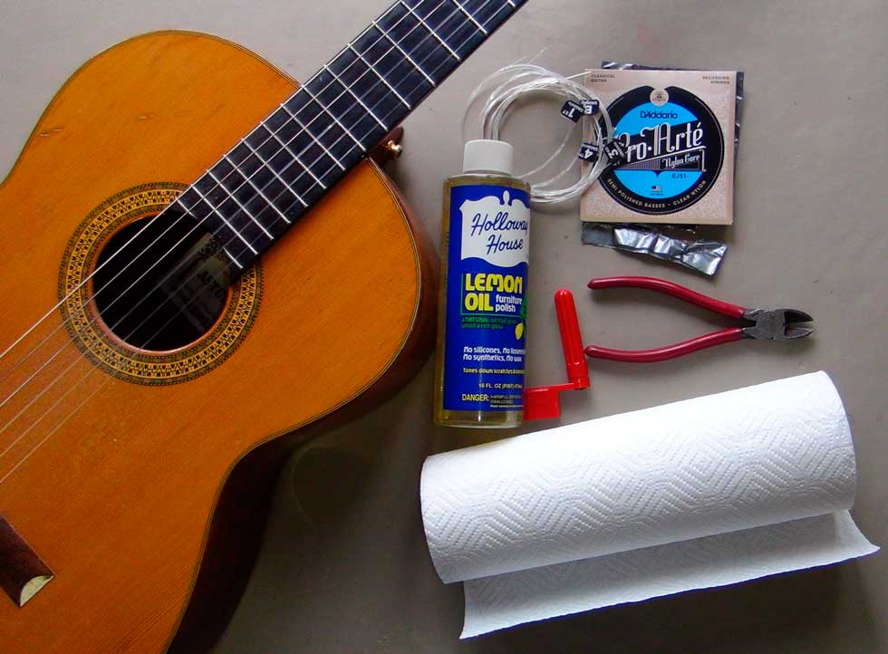 Changing Strings On a Nylon String Guitar and Oiling the Fingerboard
